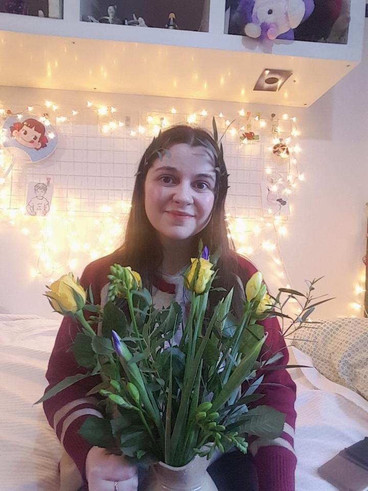 [imagine description: the author, Ru Raynor, holding a bouquet of flowers]
